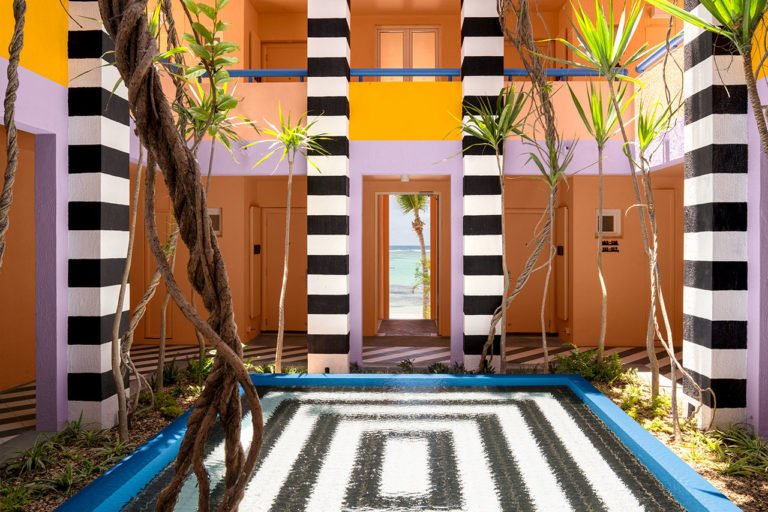 A colorful 80's style interior design hotel in Mauritus, y Camille Walala.